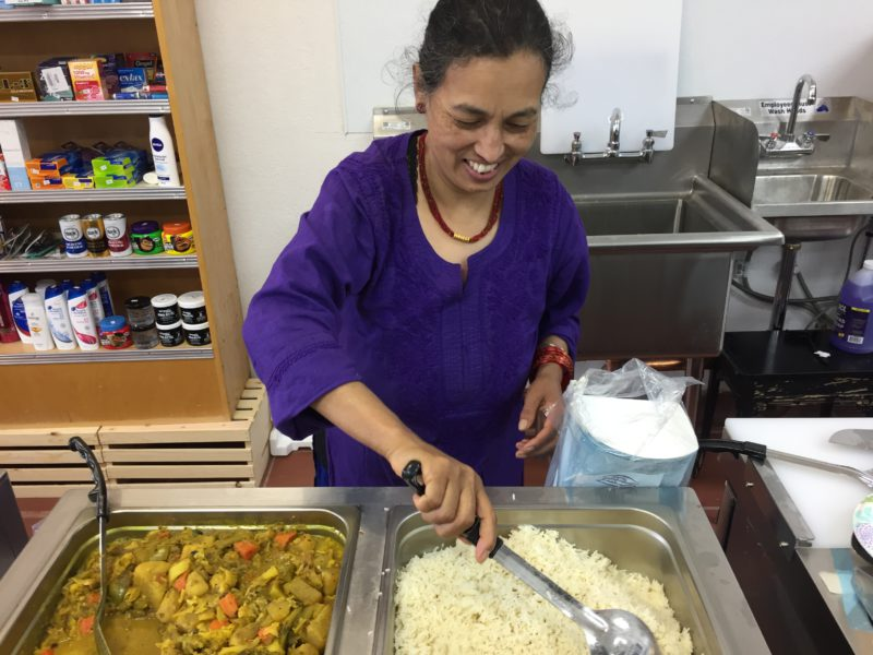 Lila Singh serves up hot Nepalese food at the grand opening of Kathmandu Market and Deli on Telegraph Avenue in Berkeley. Photo: Natalie Orenstein